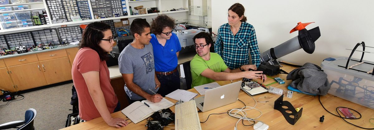 Group of 5 students working in a lab.